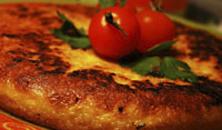 Spaanse tortilla met champignons en tomaat